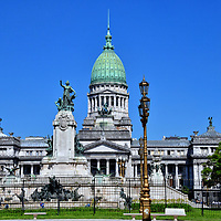 Palace of Argentine Congress in Balvanera, Buenos Aires, Argentina<br /> The centerpiece of Congressional Plaza is an elaborate water fountain graced with bronze sculptures by artist Jules Lagae. In the center is the Allegory of the Republic. Called the Monument of the Two Congresses, these sculptures celebrate the centennial anniversary of two assemblies. Together they achieved Argentina's independence from the Spaniards in 1816. This gorgeous park is one of three squares in front of the Palace of the Argentine National Congress. A green, 260 foot dome crowns the white marble façade. The Neoclassical design by architect Vittorio Meano was finished in 1906. The palace is a National Historic Landmark.