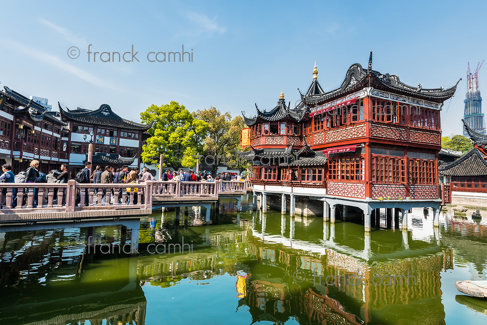 Shanghai, China - April 7, 2013: people outside of the oldest tea house of Fang Bang Zhong Lu at the old city of Shanghai in China on april 7th, 2013