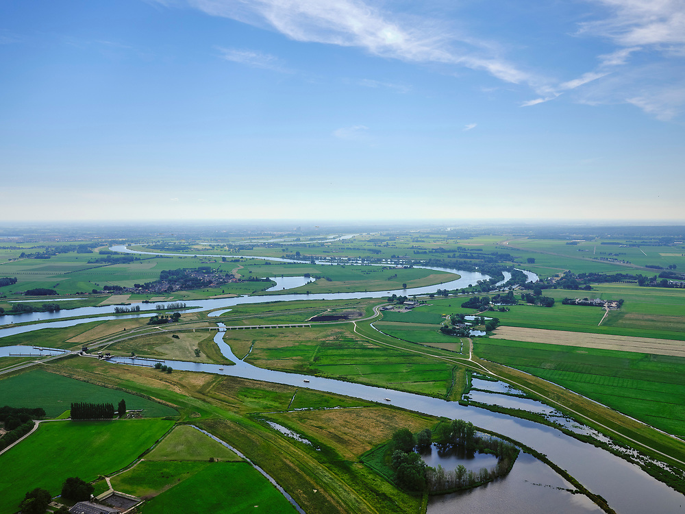 "Nederland, Overijssel, Gemeente Kampen; 21–06-2020; het Reevediep ter plaatse van De Koerskolk, rivier de IJssle in de achtergrond. Voor de aanleg van het Reevediep liep ter hoogte van dit natuurgebied in Kamperveen het riviertje Reeve.<br /> Het Reevediep is aangelegd in het kader van het project Ruimte voor de Rivier om bij hoogwater water af te voeren voordat dit het nabij gelegen Kampen bereikt, direct naar het IJsselmeer, de 'bypass Kampen'. Het Reevediepgebied is ook een natuurgebied en vormt een ecologische verbindingszone tussen rivier de IJssel en Drontermeer.<br /> Reevediep, nature reserve Koerskolk. <br /> The Reevediep has been constructed as part of the Room for the River project, and functions to discharge high waters before reaching the nearby Kampen, directly to the IJsselmeer, the ""bypass Kampen"". The Reevediep area is also a nature reserve and forms an ecological connecting zone between the river IJssel and Drontermeer.<br /> <br /> luchtfoto (toeslag op standaard tarieven);<br /> aerial photo (additional fee required)<br /> copyright © 2020 foto/photo Siebe Swart"