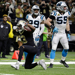 Jan 7, 2018; New Orleans, LA, USA; New Orleans Saints wide receiver Michael Thomas (13) reacts after catching a pass against Carolina Panthers strong safety Mike Adams (29) and middle linebacker Luke Kuechly (59) during the fourth quarter in the NFC Wild Card playoff football game at Mercedes-Benz Superdome. Mandatory Credit: Derick E. Hingle-USA TODAY Sports