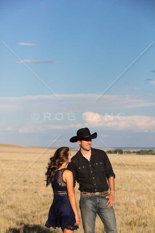 cowboy and a girl on a ranch