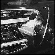 Headlight of a late model car, in black and white
