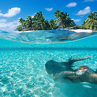 Cook Islands, K?ki '?irani, South Pacific Ocean, Aitutaki, One Foot Island, over/under photo of girl swimming
