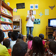 Dulce Lopes gets the children warmed up with some singing and music in Alola's small premisses in a Dili suburb. The Alola Foundation provide pre-school play and learn sessions. Education in Timor-Lest is very basic with classes up to 80 children and teachers trained under an old fashioned system with very little inter-action between teacher and pupils..Fundasaun Alola is a not for profit non government organization operating in Timor Leste to improve the lives of women and children. Founded in 2001 by the then First Lady, Ms Kirsty Sword Gusmao, the organization seeks to nurture women leaders and advocate for the rights of women.