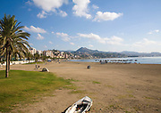 Sandy beach in front of apartment blocks in the city of Malaga, Spain
