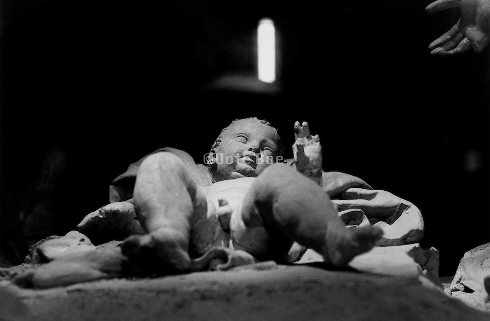 view of reclining baby Jesus statue