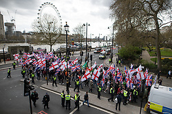 © Licensed to London News Pictures . 01/04/2017 . London , UK . Britain First demonstration passes along Victoria Embankment . The EDL and Britain First both hold demonstrations in London , opposed by anti-fascist groups , including Unite Against Fascism . Photo credit : Joel Goodman/LNP