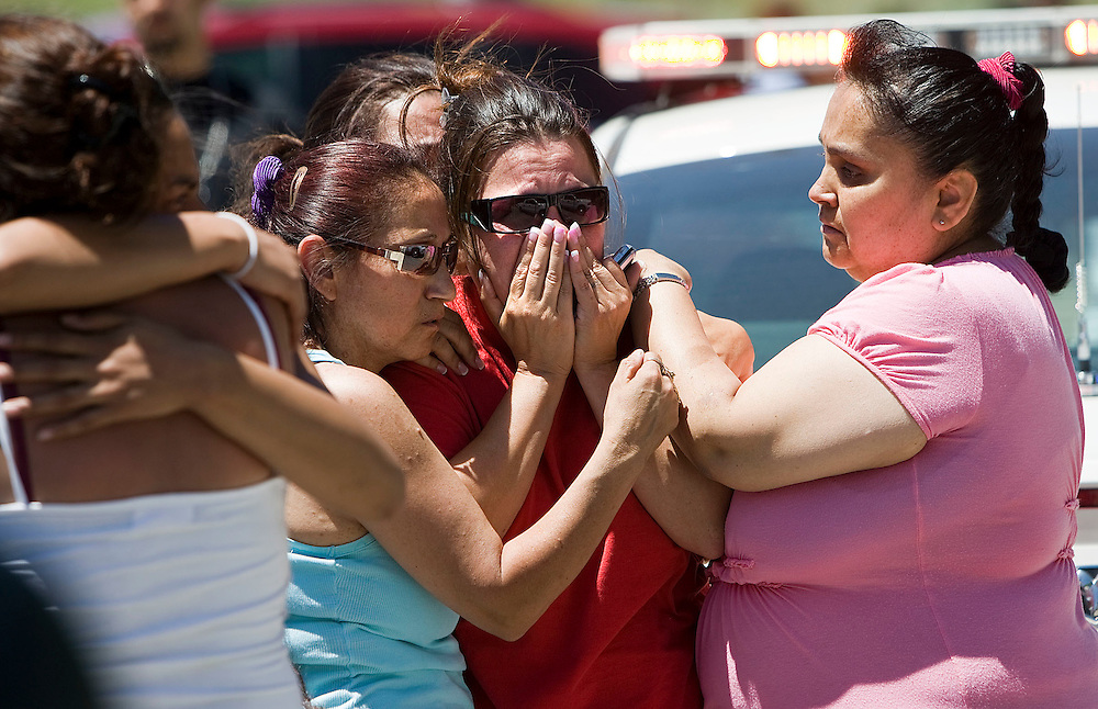Tracy Martin, center of Ogden, whose daughter Fealina Espinoza was killed in the crash, along with four others,  is consoled by family and friends as she wails in grief as the body of her daughter drives past in an ambulance after a fatal accident claimed the lives of 5 young people on SR39 east of Huntsville, Utah, Saturday, June 26, 2010. Police had closed off the road and family members gathered at the road block. August Miller, Deseret News .