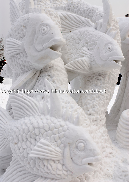 Snow sculpture of fish at Sapporo snow sculpture festival on Hokkaido Island in Japan