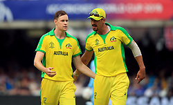 Australia's Jason Behrendorff celebrates with Mitchell Starc (right) after taking the wicket of England's Chris Woakes (not in picture) during the ICC Cricket World Cup group stage match at Lord's, London.