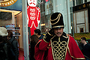 A caped greeter in a tall hat trimmed with gold braid greets visitors to the F A O Schwarz toy store in Manhattan's midtown.