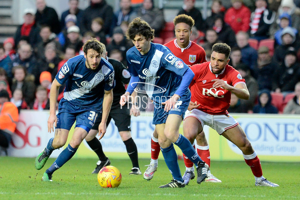 Birmingham City striker Diego Fabbrini on the attack watched by Bristol City defender Scott Golbourne during the Sky Bet Championship match between Bristol City and Birmingham City at Ashton Gate, Bristol, England on 30 January 2016. Photo by Alan Franklin.