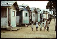 Group of girls walks past homes @ Seringal Mourao, failed rubber tapper community on Eiru River. Brazil
