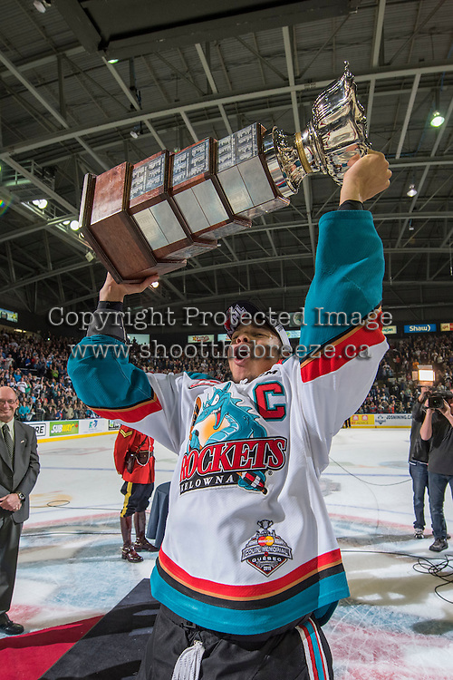 KELOWNA, CANADA - MAY 13: Captain Madison Bowey #4 of Kelowna Rockets hoists the WHL Championship trophy into the air on May 13, 2015 during game 4 of the WHL final series at Prospera Place in Kelowna, British Columbia, Canada.  (Photo by Marissa Baecker/Shoot the Breeze)  *** Local Caption *** Madison Bowey;