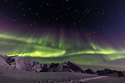 The northern lights come and go quite quickly. This is a particularly impressive show with a shooting star. (Photo by Travel Photographer Matt Considine)
