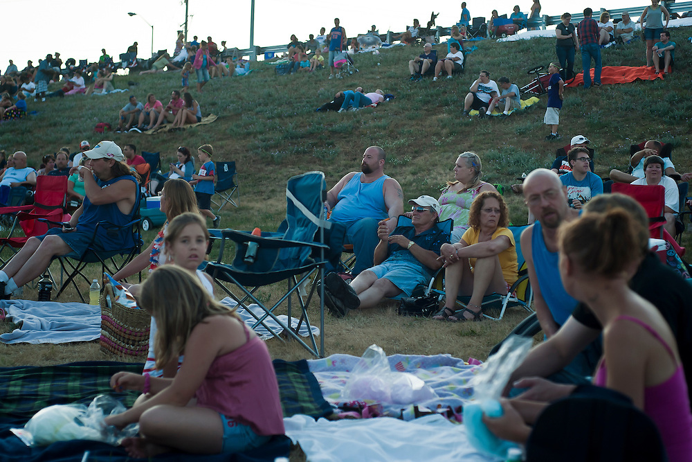 Lathan Goumas for the Midland Daily News..People stake out seats at the base of the Liberty Bridge to watch the finale of the 50th Bay City Fireworks Festival hours before the show begins on Saturday, July 7, 2012. In celebration the festival planned to fire off 50,000 fireworks in 50 minutes on the final day of the three day event.