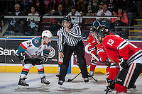KELOWNA, CANADA - APRIL 19: Lilnesman, Justin Hull blows the whistle for the face off between # of the Kelowna Rockets and Portland Winterhawks on April 18, 2014 during Game 2 of the third round of WHL Playoffs at Prospera Place in Kelowna, British Columbia, Canada.   (Photo by Marissa Baecker/Shoot the Breeze)  *** Local Caption *** Justin Hull;