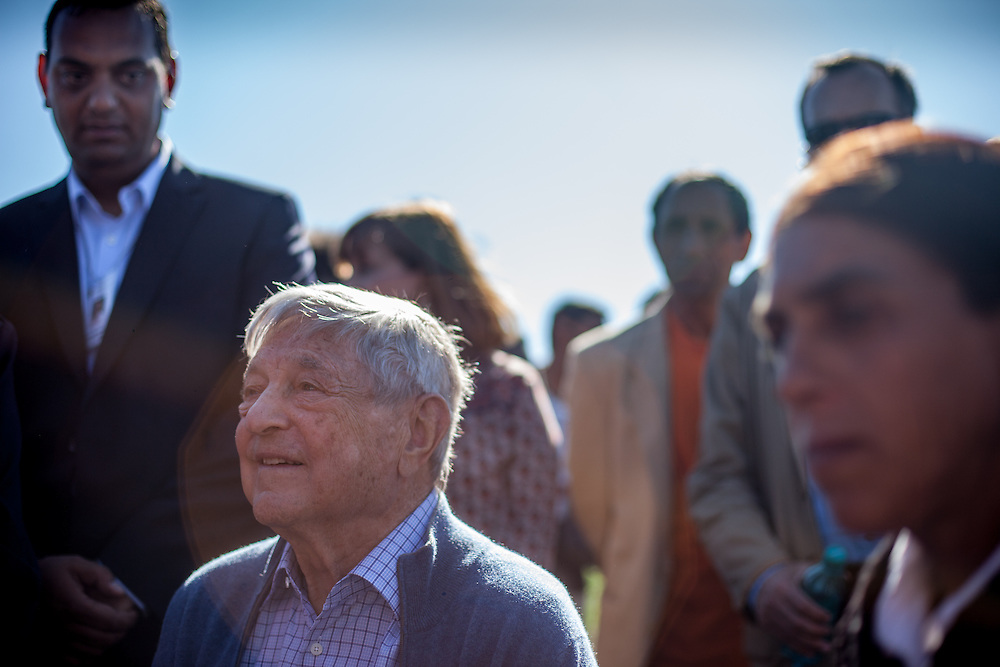 George Soros, chairman and founder of the Open Society Foundations meets with Alecu Nela, a local Roma mother. In the background, Cristian Buceanu (left), a Roma council member for Frumuşani, elected through local support in 2012.