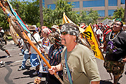 May 29 - PHOENIX, AZ: Pro-immigrant marchers in the streets of Phoenix, AZ, Saturday. More than 30,000 people, supporters of immigrants' rights and opposed to Arizona SB1070, marched through central Phoenix to the Arizona State Capitol Saturday. SB1070 makes it an Arizona state crime to be in the US illegally and requires that immigrants carry papers with them at all times and present to law enforcement when asked to. Critics of the law say it will lead to racial profiling, harassment of Hispanics and usurps the federal role in immigration enforcement. Supporters of the law say it merely brings Arizona law into line with existing federal laws.  Photo by Jack Kurtz / ZUMA Press