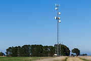 Rural cellular, microwave and communications antenna array for the mobile telephone system on a triangular lattice tower and equipment enclosure shelter in country Victoria, Australia. <br />