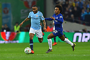 Raheem Sterling (7) of Manchester City on the attack chased by Willian (22) of Chelsea during the Carabao Cup Final match between Chelsea and Manchester City at Wembley Stadium, London, England on 24 February 2019.
