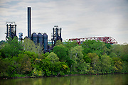 The Carrie Furnaces were built in 1881 as part of U.S. Steel's Homestead Works, a sprawling 400-acre complex that spanned both sides of the Monogahela river. They produced up to 1,250 tons of steel a day until 1978 when they were closed. While the majority of the site was razed for developments that never materialized (and a shopping center that did), the 100-foot high furnaces still stand; now they are an extremely rare example of pre-WWII ironmaking technology. The furnaces were designated as a national historic landmark in 2006 and preservation efforts are underway.