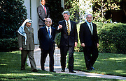 US President Bill Clinton walks mid-east leaders through the White House Rose Garden October 1, 1996 during the Middle East Peace Summit in Washington, DC.  The group is (L-R) Palestinian Leader Yasser Arafat, King Hussein of Jordan, President Bill Clinton and Israel Prime Minister Benjamin Netanyahu.