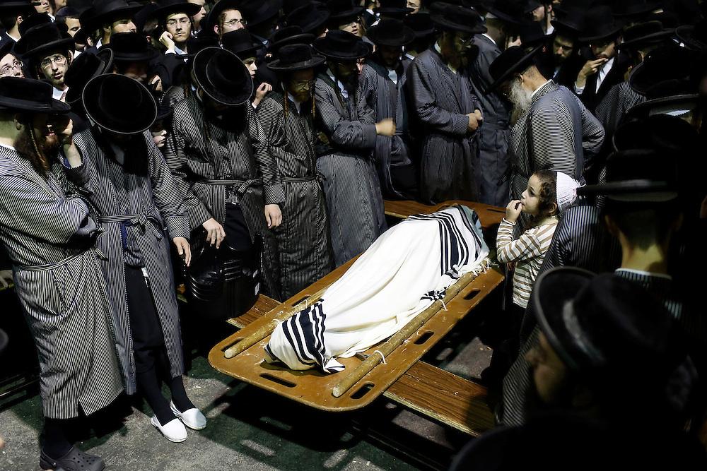 Ultra-Orthodox Jews attend the funeral of Abraham Wallace in Jerusalem's Mea Shearim neighbourhood.