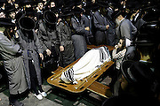 Ultra-Orthodox Jews attend the funeral of Abraham Wallace in Jerusalem's Mea Shearim neighbourhood.