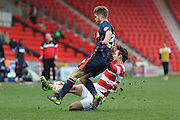 Doncaster Rovers defender Mitchell Lund (2)  tackles Blackpool defender Luke Higham (24)  during the Sky Bet League 1 match between Doncaster Rovers and Blackpool at the Keepmoat Stadium, Doncaster, England on 28 March 2016. Photo by Simon Davies.