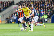 Oxford United's goalscorer Danny Hylton is challenged by Luton Town's Alan Sheehan during the Sky Bet League 2 match between Oxford United and Luton Town at the Kassam Stadium, Oxford, England on 16 April 2016. Photo by Shane Healey.