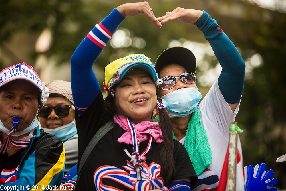 19 FEBRUARY 2014 - BANGKOK, THAILAND: Anti-government protestors form a heart with their hands during a protest in Bangkok. Anti-government protests organized by Suthep Thaugsuban and the People's Democratic Reform Committee have gridlocked parts of Bangkok since November.    PHOTO BY JACK KURTZ