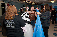 Michelle Corliss of Meredith gets help from Kelly Ainsworth Hope, Faith and Love volunteer and her mom Marcia in making her prom dress selection during the 5th annual Gowns for Girls event Saturday morning at Franklin Community Center.  (Karen Bobotas/for the Laconia Daily Sun)