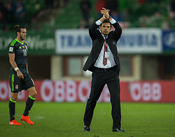 VIENNA, AUSTRIA - Thursday, October 6, 2016:  Wales' manager Chris Coleman claps his hands to the travelling supporters after Wales draw the match 2-2 with Austria during the 2018 FIFA World Cup Qualifying Group D match at the Ernst-Happel-Stadion. (Pic by Peter Powell/Propaganda)