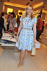 TANIA BRYER at a fun filled tea party hosted by Roger Vivier to view their Jeune Fille collection of shoes in aid of Mothers4Children held at Roger Vivier, Sloane Street, London on 27th March 2012.