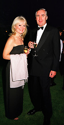 MR & MRS BILL ALEXANDER at a party in Oxfordshire on 11th September 1999.MWE 31