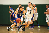 Vergennes' Caroline Johnston (15) dribbles the ball around Winooski's Lydia Nattress (12) during the girls basketball game between Vergennes and Winooski at Winooski High School on Wednesday night December 9, 2015 in Winooski. (BRIAN JENKINS/for the FREE PRESS)