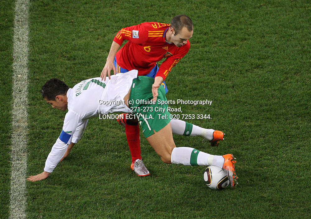 29/06/2010 World Cup. Spain v Portugal.<br /> Cristiano Ronaldo is stopped by Andres Iniesta.<br /> Photo: Mark Leech.