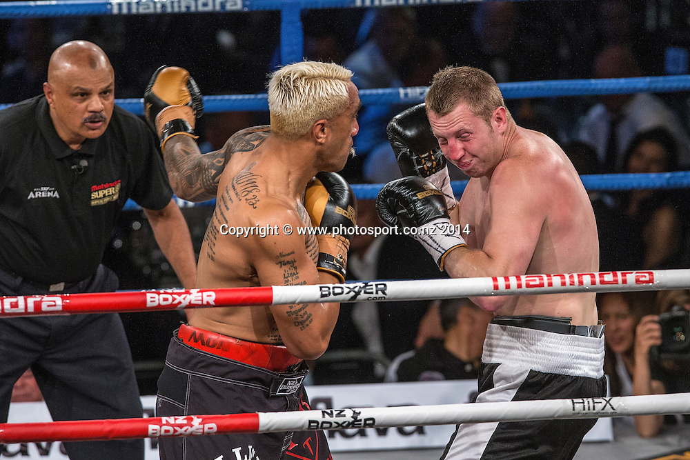 Monty Filimaea (L) fights James Emerson in the Mahindra Super 8 Fight Night, North Shore Events Centre, Auckland, New Zealand, Saturday, November 22, 2014. Photo: David Rowland/Photosport