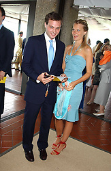 The HON.ED SACKVILLE and LADY ALEXANDRA GORDON-LENNOX at the 4th day of the 2005 Glorious Goodwood horseracing festival at Goodwood Racecourse, West Sussex on 29th July 2005.    <br />