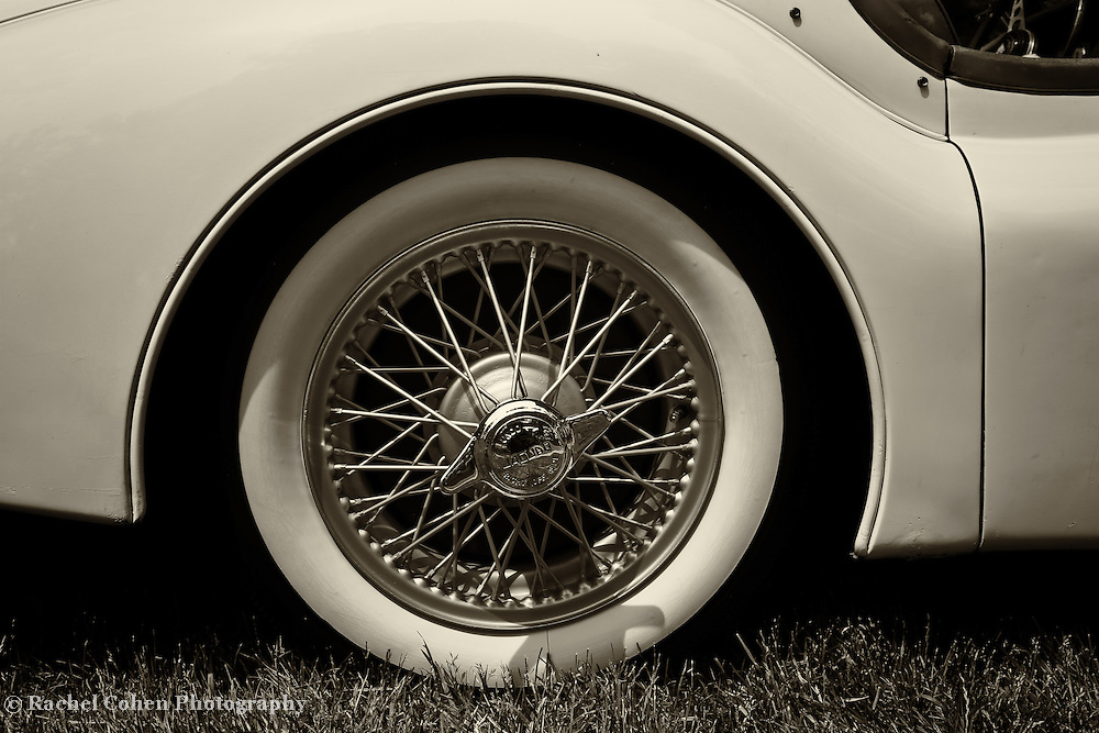 &quot;1955 Jaguar&quot; 2 mono<br /> <br /> An awesome monochrome view of the right side and wire rimmed wheel of a 1955 Jaguar. <br /> <br /> Cars and their Details by Rachel Cohen