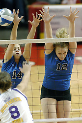 24 November 2006: Lara Rowen strikes the ball past Korie Lebeda and Kelly Goc during a Semi-final match between the Creighton University Bluejays and the Northern Iowa University Panthers. The Tournament was held at Redbird Arena on the campus of Illinois State University in Normal Illinois.<br />
