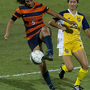 11/3/16-9:32:34 PM Cal State Fullerton Forward Maribell Morales moves the ball against UC Irvine Forward Carley Brown in the Big West Tournament semifinal game.