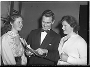 07/11/1959<br /> 11/07/1959<br /> 07 November 1959<br /> All Ireland Final of Gael Linn Children's Singing Competition at Francis  Xavier Hall, Dublin. Picture shows Diarmuid O Broin, Director of the Competition, chatting to the two Cork entrants before they went on stage. Aine Ní Rinn of Millstreet Cork (left), who won 1st prize and Maire Ní Dhoibhlinn of Cork City who won 2nd place.