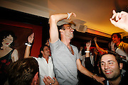 Frederick's Lounge. New York, New York.  Unites States..October 14th 2006..Red Bulls French soccer player Youri Djorkaeff parties with familly and friends after a game against Kansas City at the Giants Stadium.This game could have been his last one as a professional player if the Red Bulls didn't win 3-2