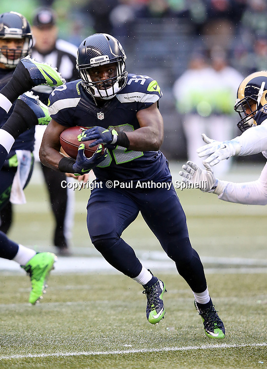 Seattle Seahawks running back Christine Michael (32) runs the ball in the third quarter during the 2015 NFL week 16 regular season football game against the St. Louis Rams on Sunday, Dec. 27, 2015 in Seattle. The Rams won the game 23-17. (©Paul Anthony Spinelli)