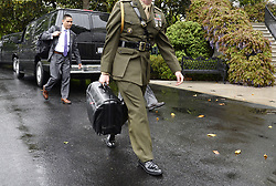 April 25, 2017 - Washington, District of Columbia, United States of America - A military aide carries the ''nuclear football'' on the South Lawn of the White House  in Washington, DC, on April 25, 2017. .Credit: Olivier Douliery / Pool via CNP (Credit Image: © Olivier Douliery/CNP via ZUMA Wire)