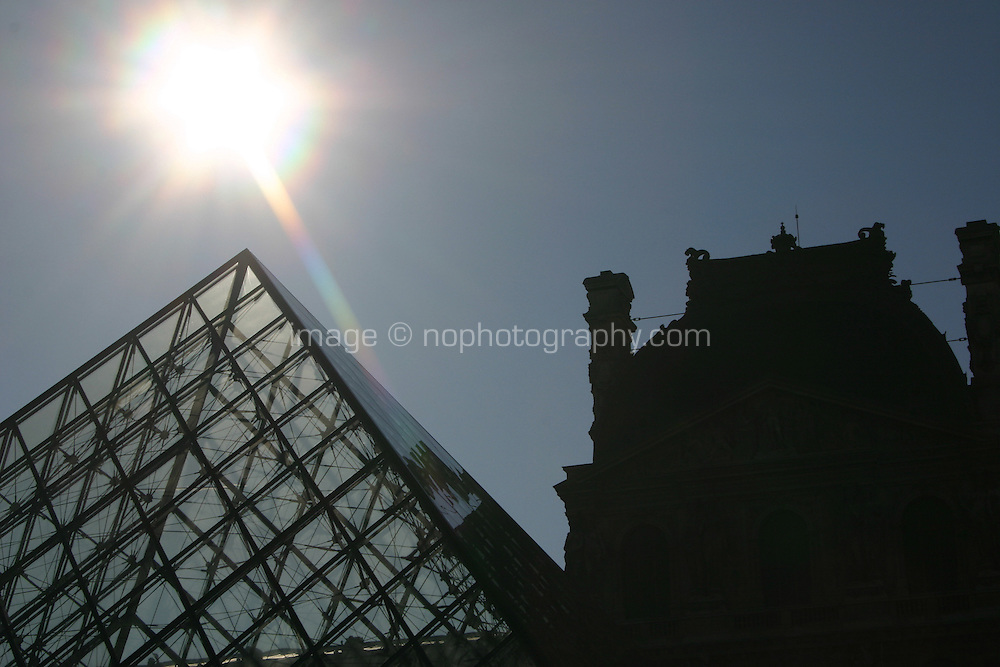 Sunlight over the glass pyramid at the Louvre, Paris, France<br />
