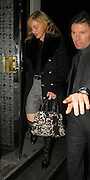 28.JANUARY.2010 - LONDON<br /> <br /> QUEEN OF POP MADONNA LEAVING LOCANDA LOCATELLI'S RESTAURANT, MAYFAIR AT 11.45 WEARING SHORTS AND KNEE HIGH LEATHER BOOTS WITH METAL STUDS ON. WHEN MADONNA ARRIVED AT THE RESTAURANT SHE WAS FOLLOWED IN BY A MYSTERY GUY WHO GOT OUT OF HER CAR BUT DIDN'T WANT TO BE PHOTOGRAPHED.<br /> <br /> BYLINE: EDBIMAGEARCHIVE.COM<br /> <br /> *THIS IMAGE IS STRICTLY FOR UK NEWSPAPERS &amp; MAGAZINES ONLY*<br /> *FOR WORLDWIDE SALES &amp; WEB USE PLEASE CONTACT EDBIMAGEARCHIVE - 0208 954 5968*