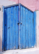 Oia, Santorini Island, Greece: blue painted wood gate